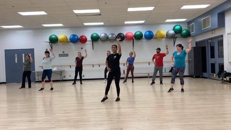 Corporal Kirandeep Braich (pictured in front in a black t-shirt) coaches a Sunday workshop session at the Col J.J. Parr Sports Centre, in Cold Lake, Alberta, on February 9, 2020. These sessions were used to teach a minute long choreography that was spread out through multiple sessions. PHOTO: Submitted