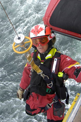Then-Warrant Officer Keith Mitchell, working from below the Cormorant helicopter during 413 (Transport and Rescue) Squadron exercises in 2008. PHOTO: DND file